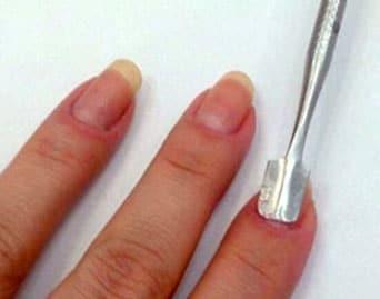 Pinza para retirar decoracion de uñas